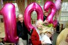 Mary Tame celebrates her 102nd birthday at Rush Court, joined by her nephew Tim O'Carroll, 68, and niece Jennifer Baggott, 72. Inset: Liaan Van Zyl, manager of The George Hotel, takes Mary out for a jaunt out on a 1955 Panther
