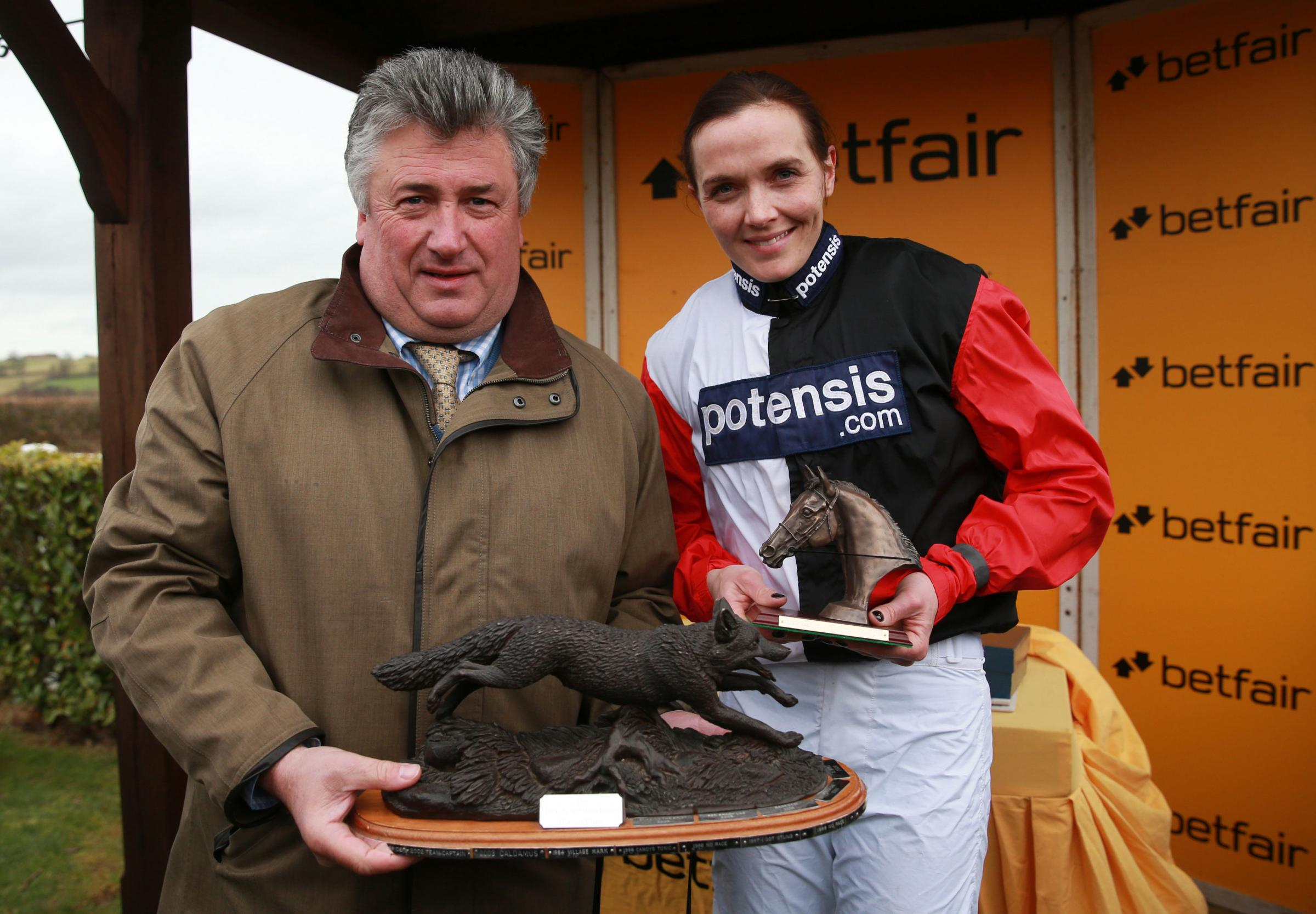 Victoria Pendleton with trainer Paul Nicholls after Pacha Du Polder's  convincing victory at Wincanton