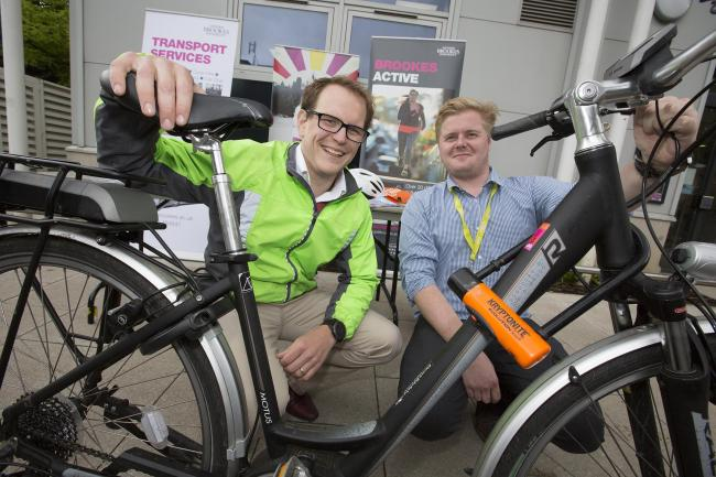 Oxford Brookes University has launched an electric bike borrowing scheme for staff. Brookes active manager, Tristan Hale (left) with transport administrator Steven Harris-Long..