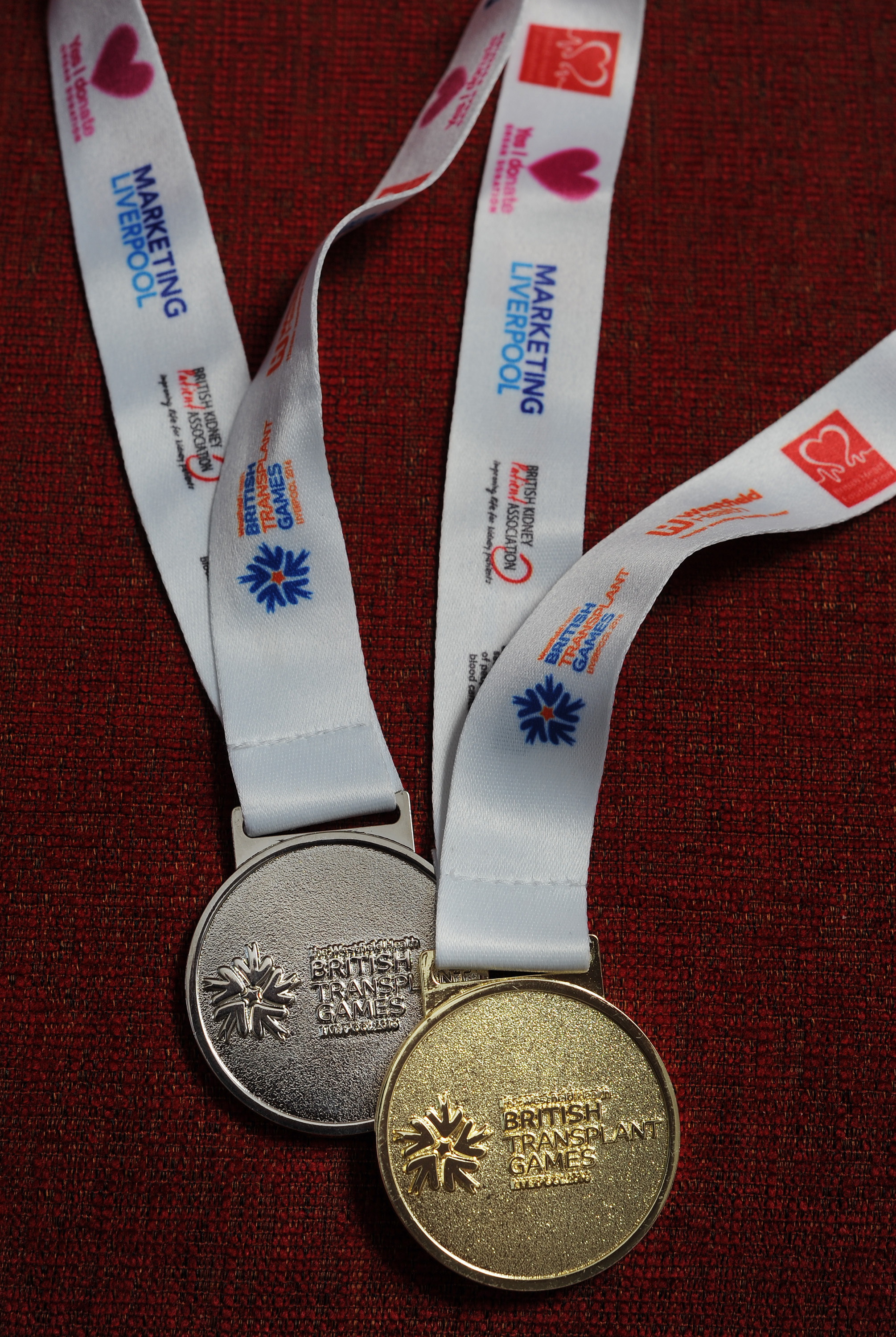 Mike Oliver's gold and silver medals from the GB Transplant Games
