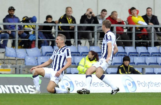 Steve Morison, pictured celebrating after scoring against Oxford United in 2016, has joined Shrewsbury Town on loan from Millwall Picture: David Fleming