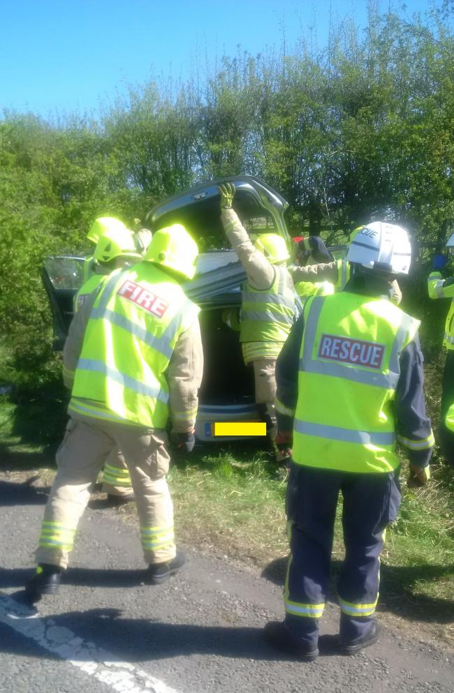 Driver cut out of car and rushed to hospital after crashing into – Hazmat Driver