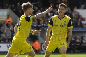 BIG HIT: Conor McAleny celebrates his second goal at Millwall on Saturday. Oxford United are keen to sign the forward permanently, but know his ten goals on loan will have caught the eye of other clubs          Picture: David Fleming