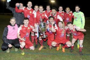 GLORY BOYS: North Leigh's players celebrate their success in last night's Oxfordshire Senior Cup final Picture: David Fleming