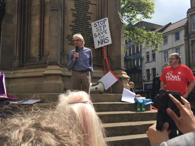 Film director Ken Loach addresses the protestors from Martyrs' Memorial