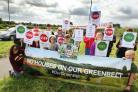 Campaigners are out in force on the A44 protesting against plans to build 4,400 homes north of Oxford. .The Begbroke and Yarnton Green Belt campaign have abandoned plans to 'repeatedly' press the pedestrian crossings on the A44 and insisted on a &
