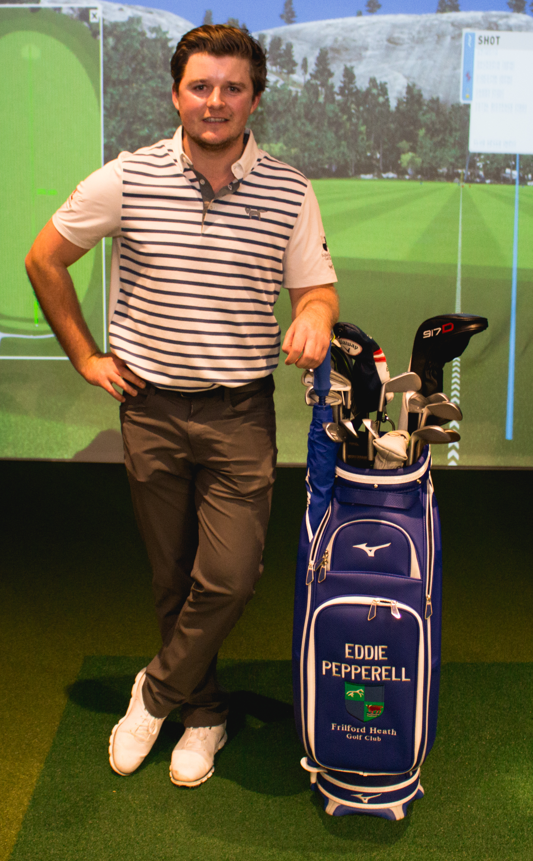 BACK AT HOME: Eddie Pepperell stands in Frilford Heath's new shot simulator, challenging members to beat his drive of 311 yards, before entertaining guests at the club with stories from the European Tour