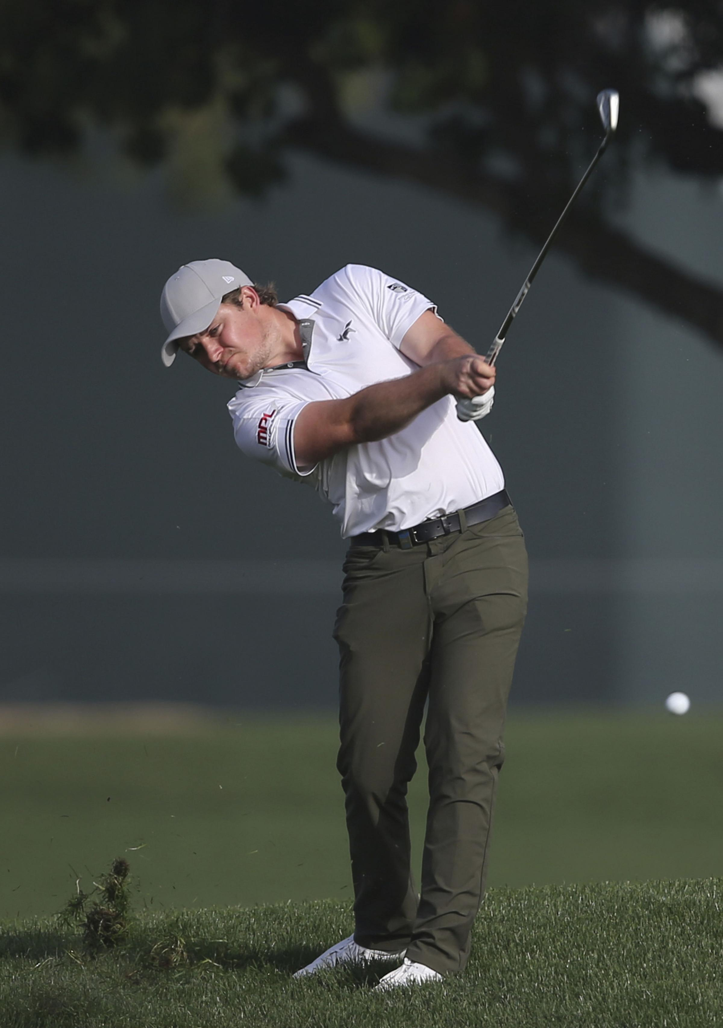 Eddie Pepperell in action at the Omega Dubai Desert Classic Picture: AP Photo/Kamran Jebreili