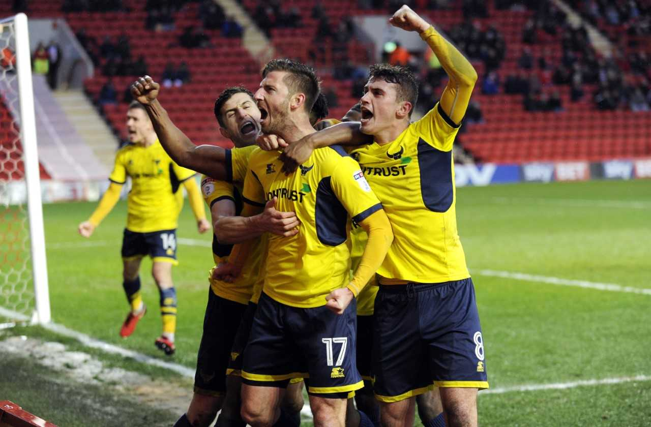 James Henry (No 17) celebrates scoring Oxford United's first goal  Picture: David Fleming
