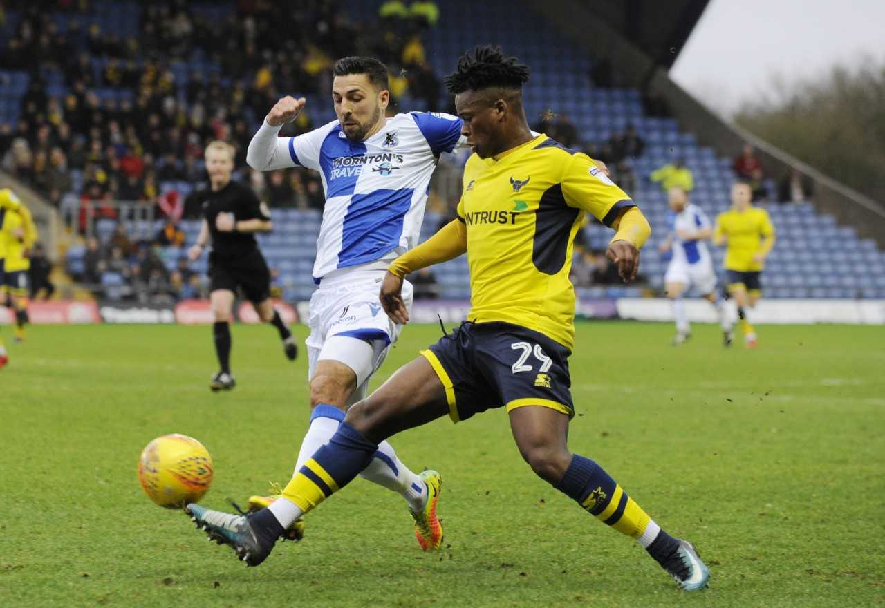 Ashley Smith-Brown is closed down by former Oxford United midfielder Liam Sercombe  Picture: David Fleming