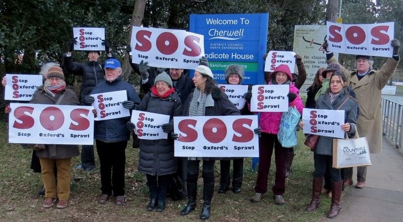 Campaigners outside Cherwell District Council on Monday ahead of the three-hour meeting