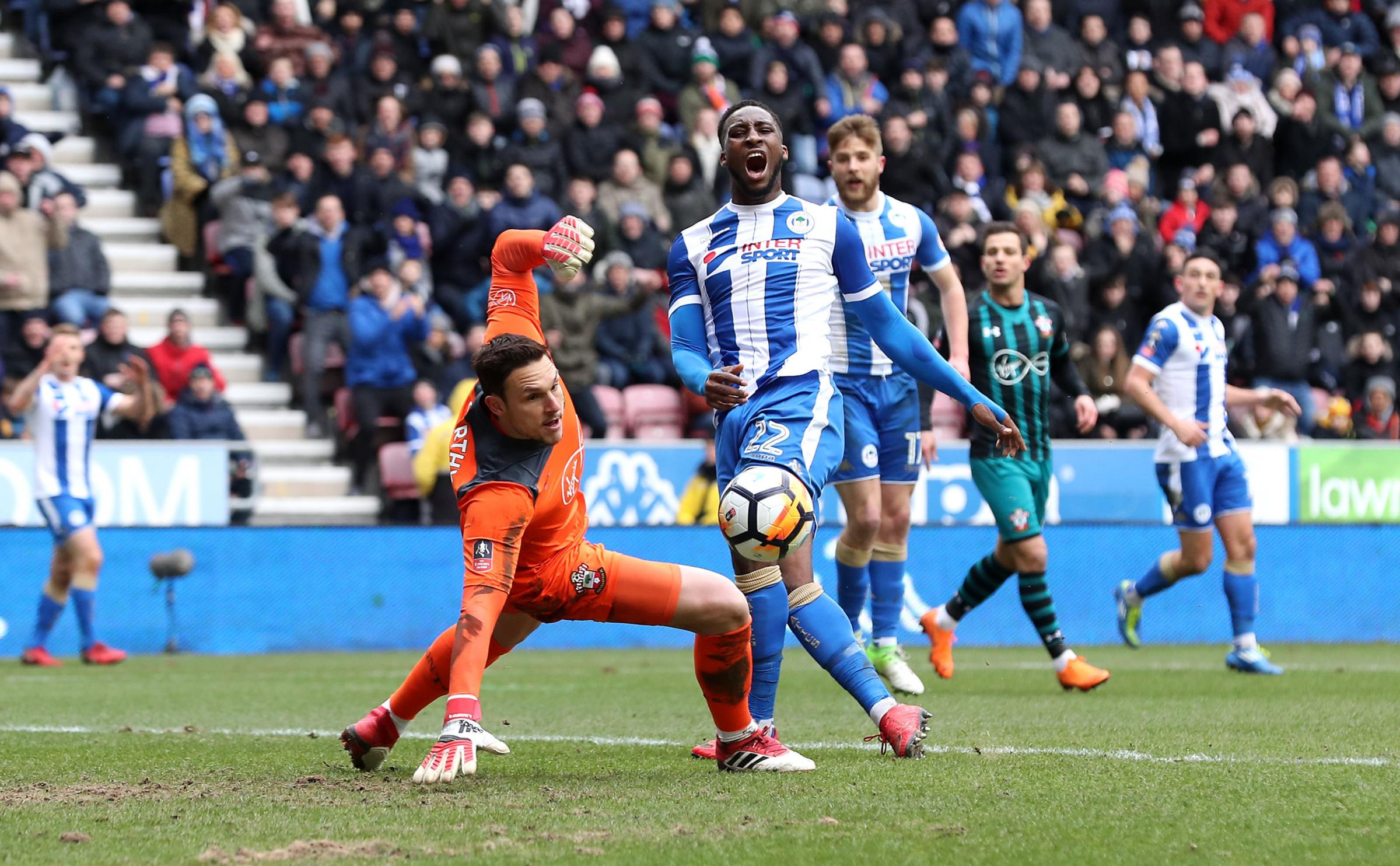 GOOD MOVE: Chey Dunkley is closing in on a second promotion in three seasons, but Wigan Athletic also reached the FA Cup quarter-final against Southampton   Picture: Martin Rickett/PA Wire