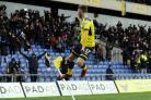 JUMPING FOR JOY: James Henry celebrates after scoring Oxford United's second goal against Peterborough on SaturdayPicture: David Fleming