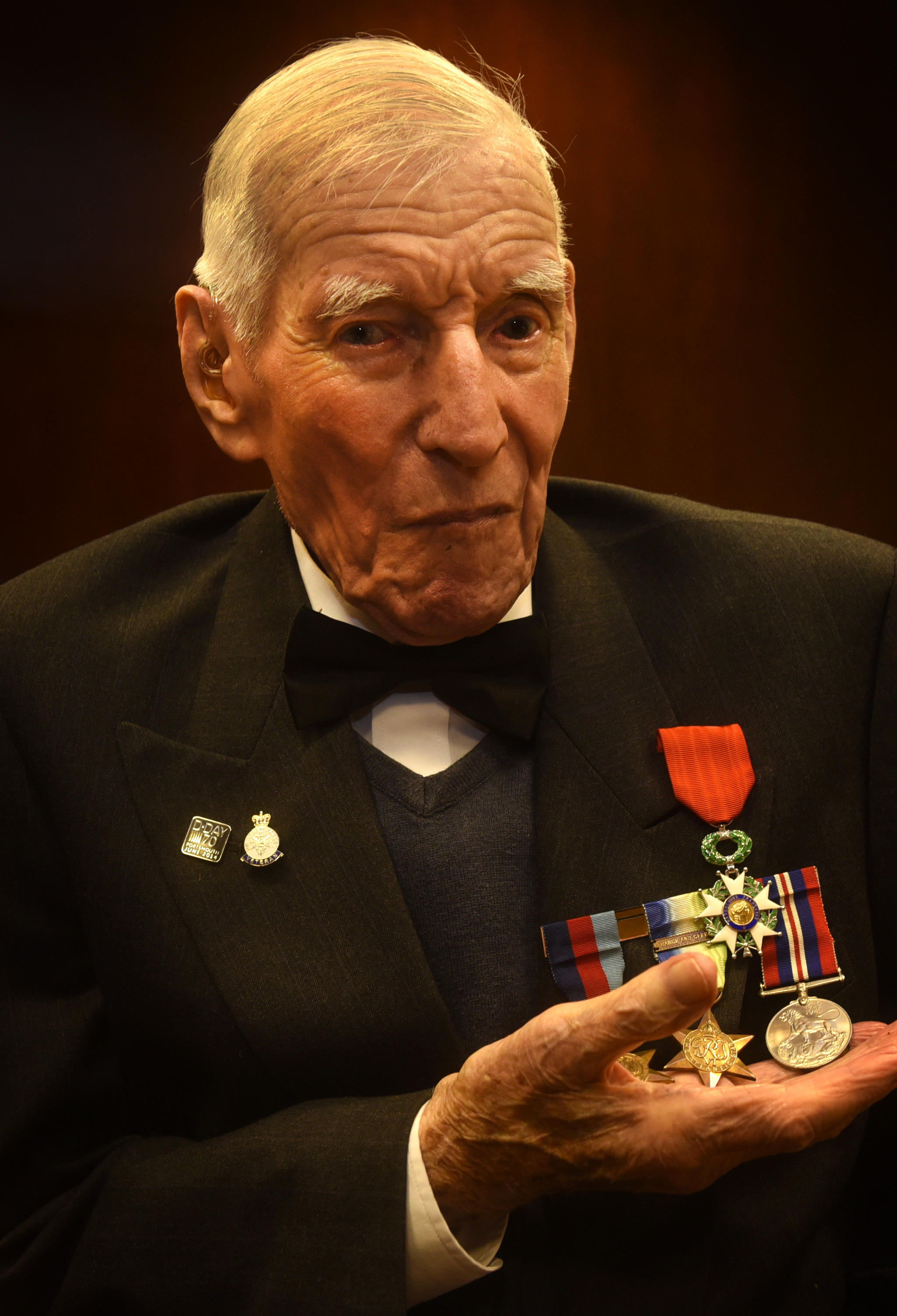 Stan Rhymes being presented with his Legion d'honneur medal by the French Ambassador Jean Pierre Jouyet on November 22, 2017. Picture: Richard Cave