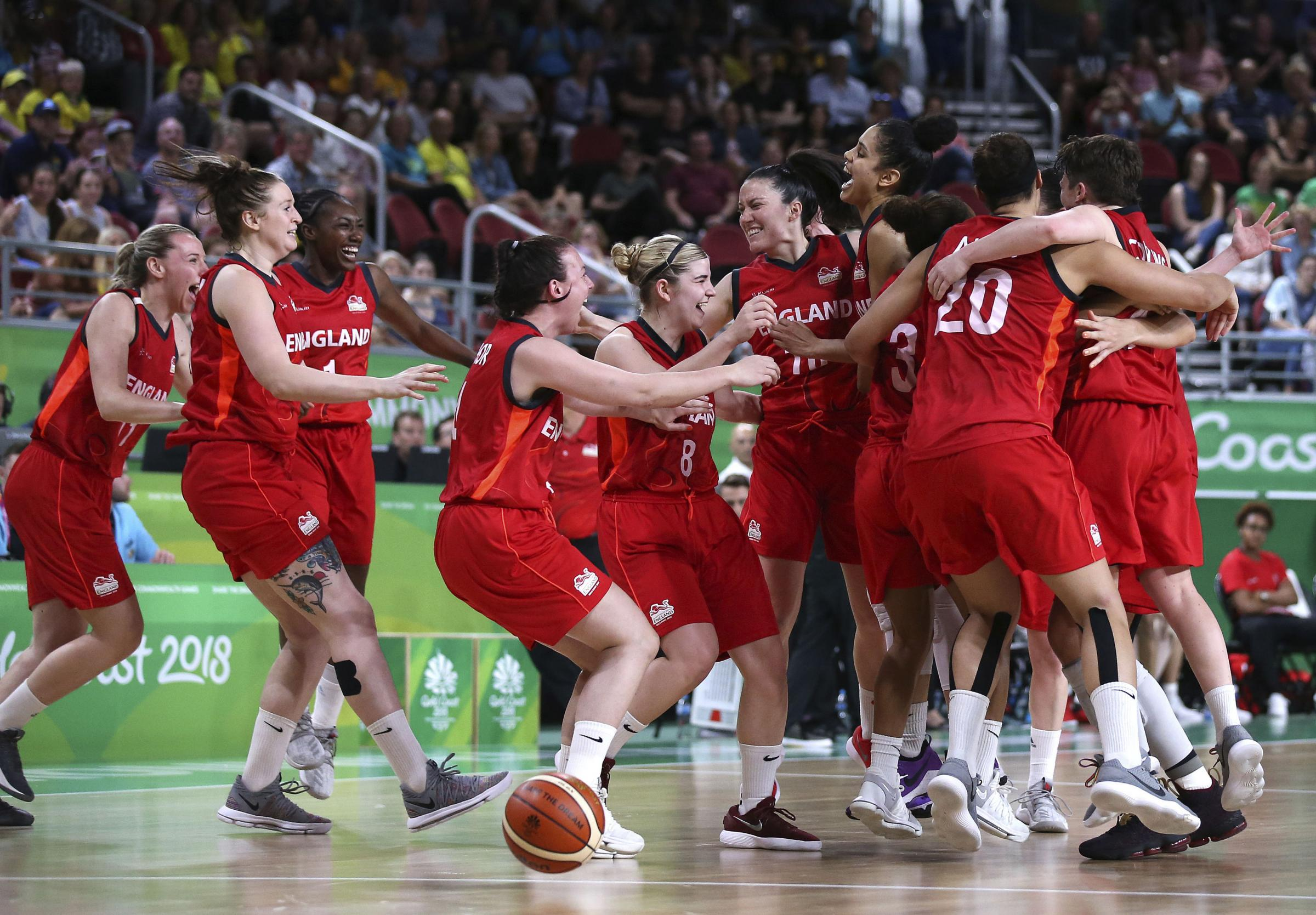 England celebrate their victory over Canada which saw them reach the final of the women's basketball at the Commonwealth Games Picture: AP Photo/Rick Rycroft