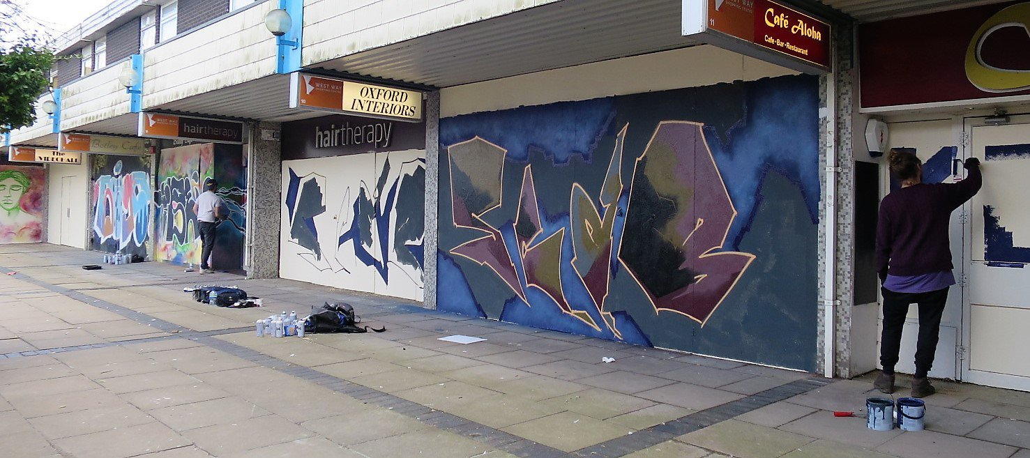 Graffiti artists brightening up the West Way shopping centre