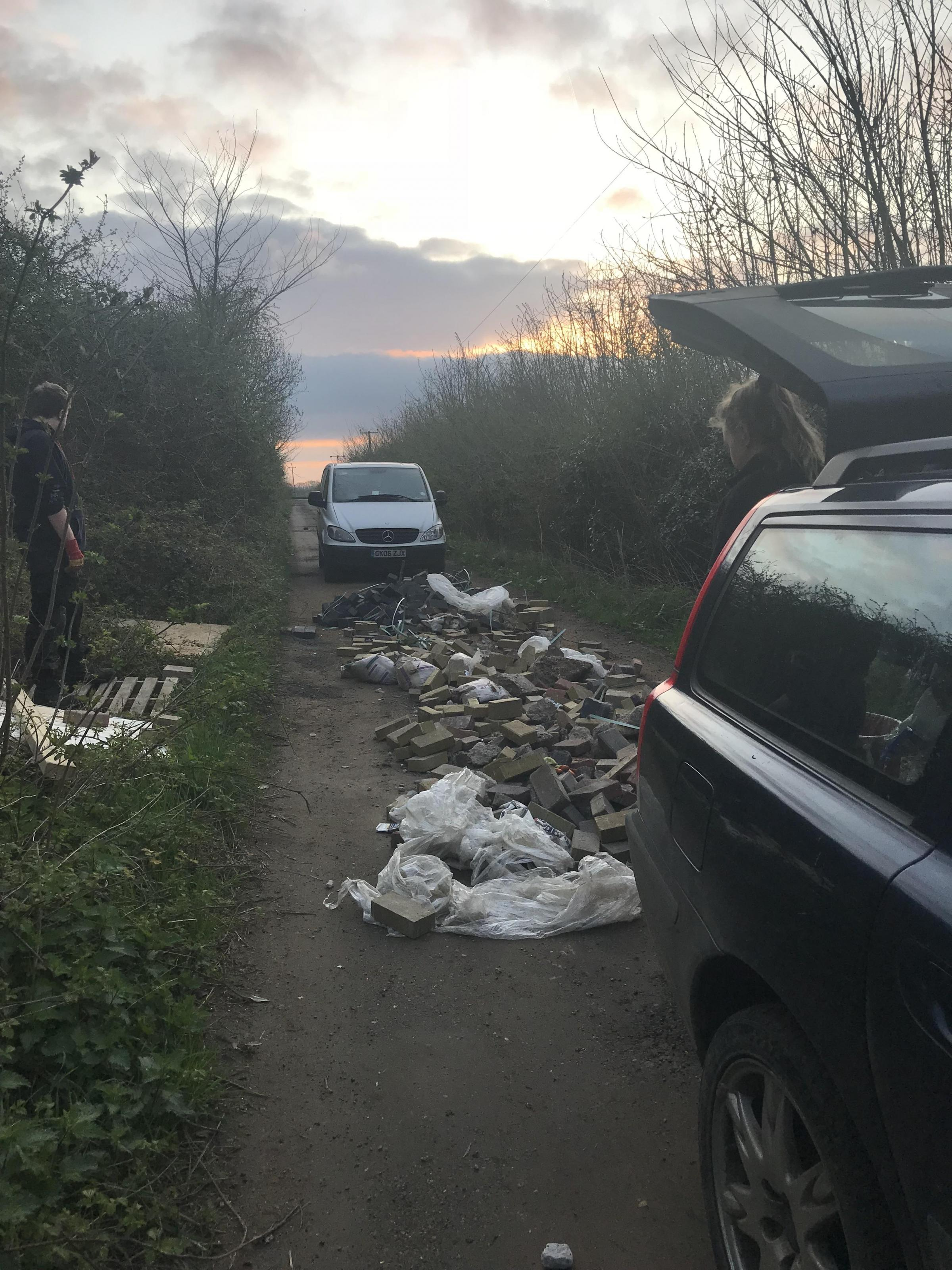 PICTURES: Fly tippers dump 'lorry load' of rubbish outside Oxfordshire home
