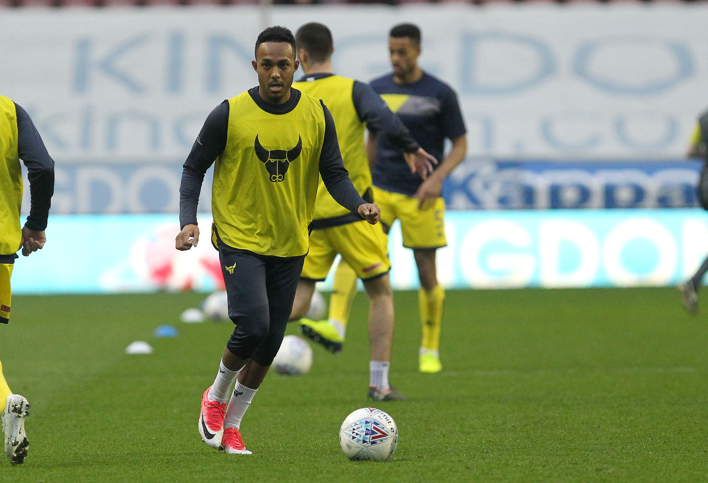 BACK IN THE FOLD: Rob Hall, pictured warming up for Oxford United at Wigan on Tuesday night, could play a cameo role at Doncaster tomorrow after recovering from injuryPicture: Richard Parkes