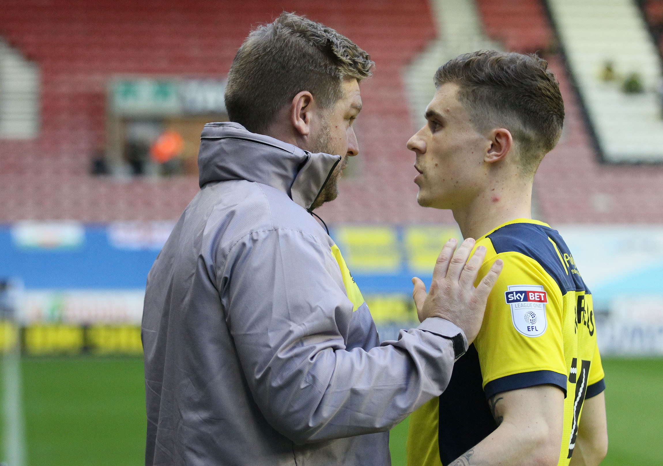 NEW BOSS: Josh Ruffels (right) gets some advice from Karl Robinson at Wigan on Tuesday night         Picture: Richard Parkes
