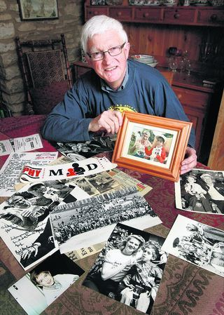 Oxford Town and Gown founder Mike Cleaver with his collection of records and pictures from past events