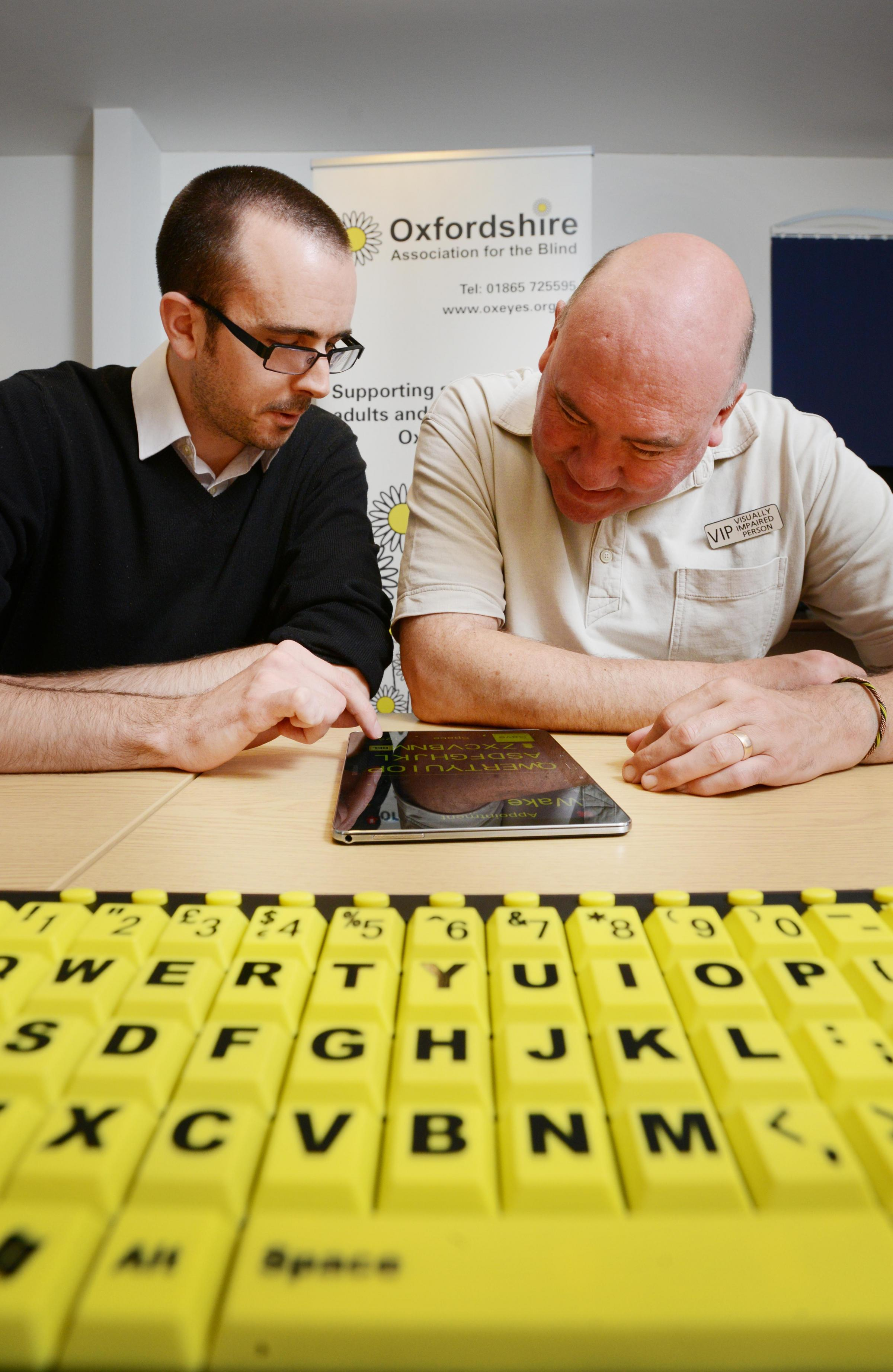SUPPRORT: Mark Upton and Guy Lawfull give IT training to visually impaired clients Picture: Richard Cave