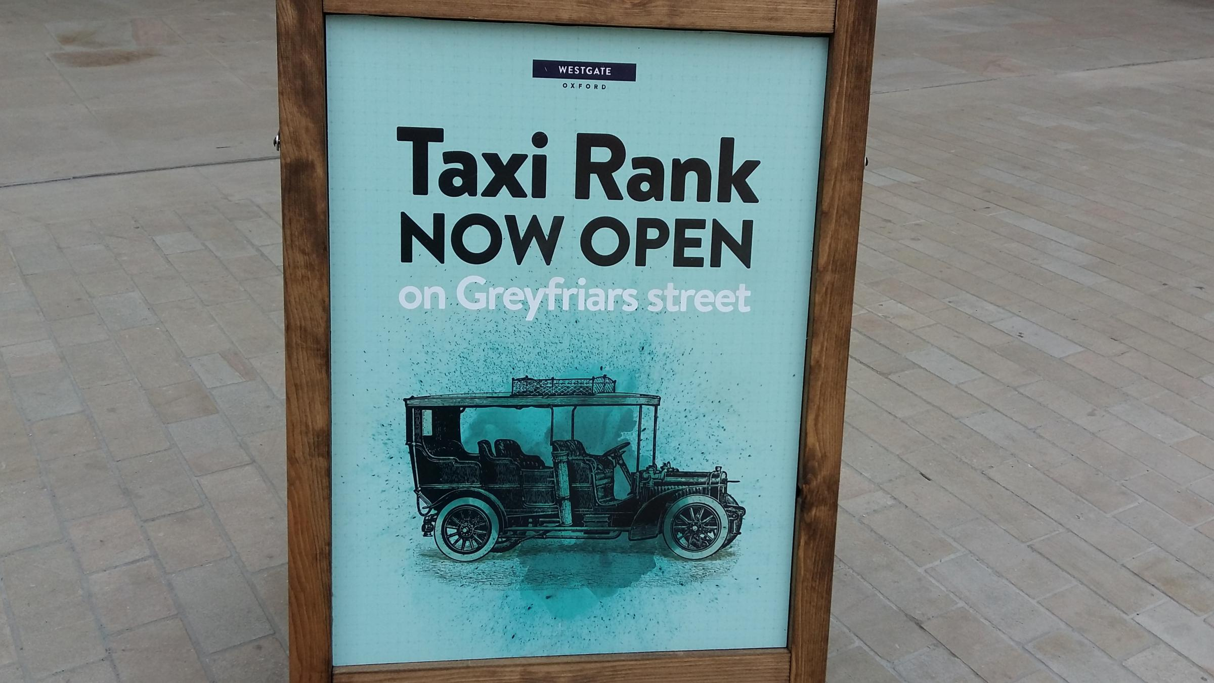 A sign at the Westgate Centre advertising the new taxi rank. Pic Andy Ffrench