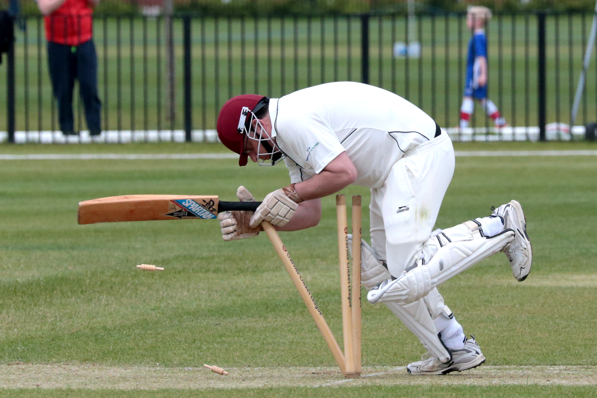 Sandford St Martin's Jonathan Springer hits his own wicket after being struck on the head by a short-pitched delivery during his side's rain-affected Cherwell League Division 2 clash at Didcot. Picture: Ric Mellis