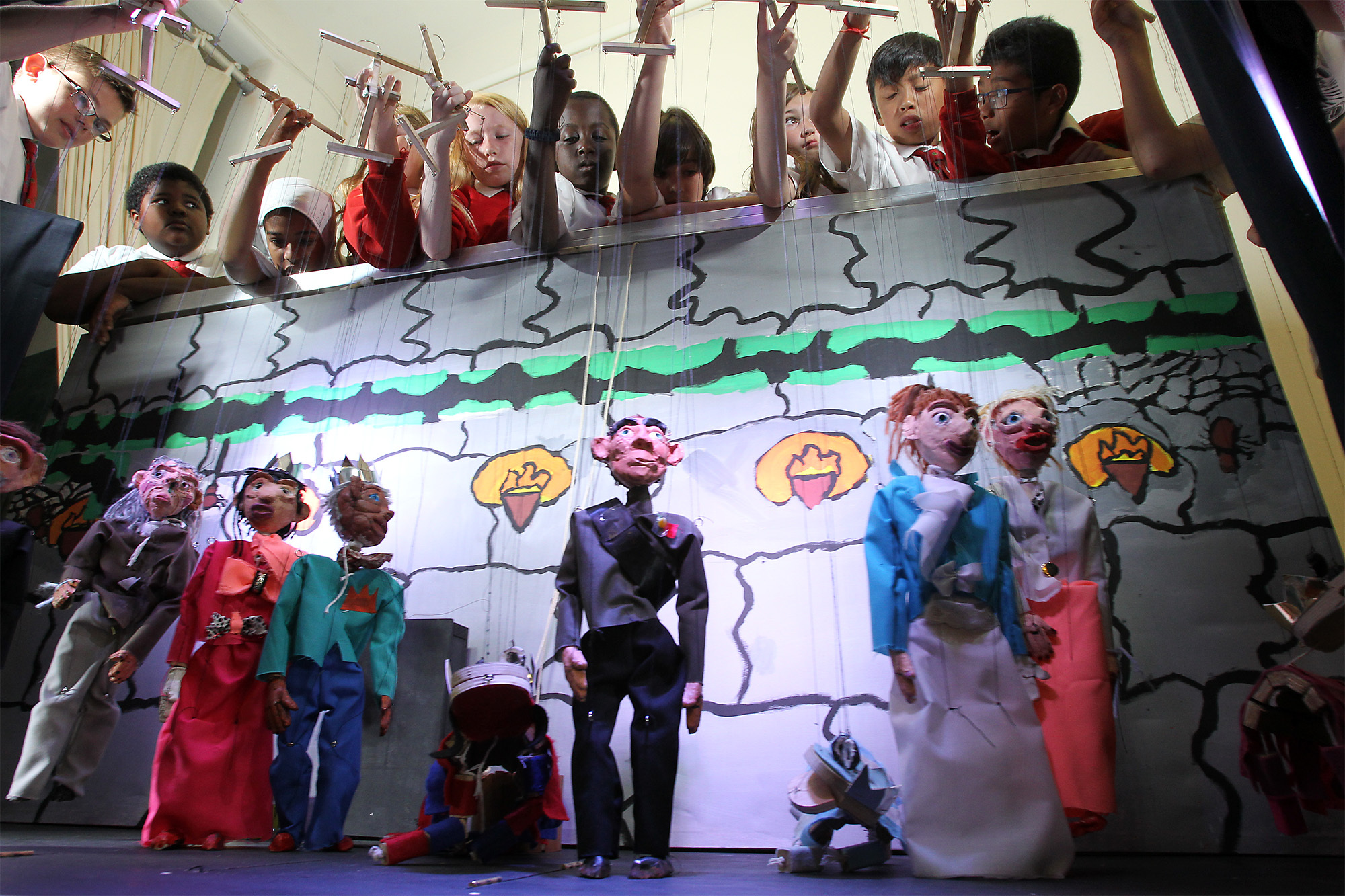 Pupils from year 6 at Orchard Meadow Primary School performing a version of the Brothers Grimm's story The Tinder Box with the Young People's Puppet Theatre at the Story Museum in Oxford in 2016