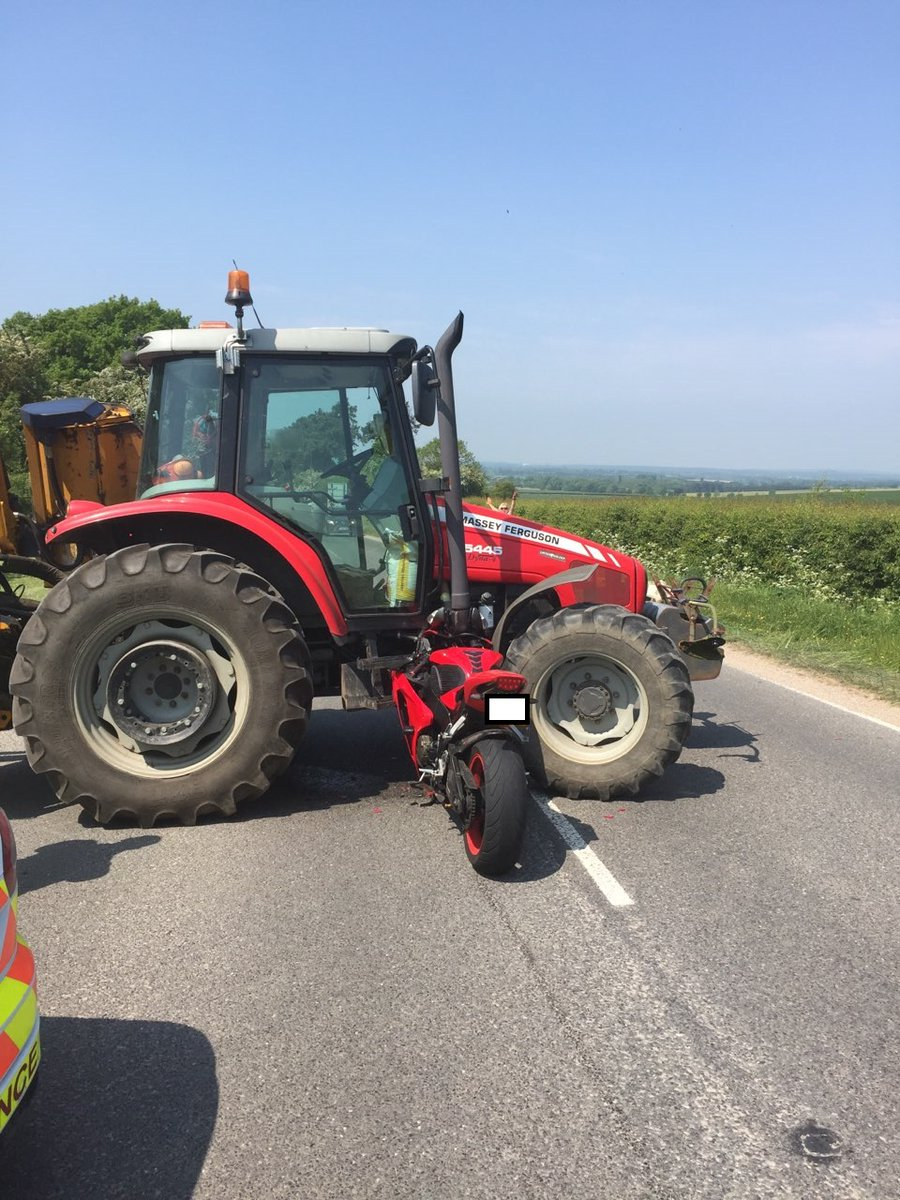 Near miss for rider as motorbike and tractor crash