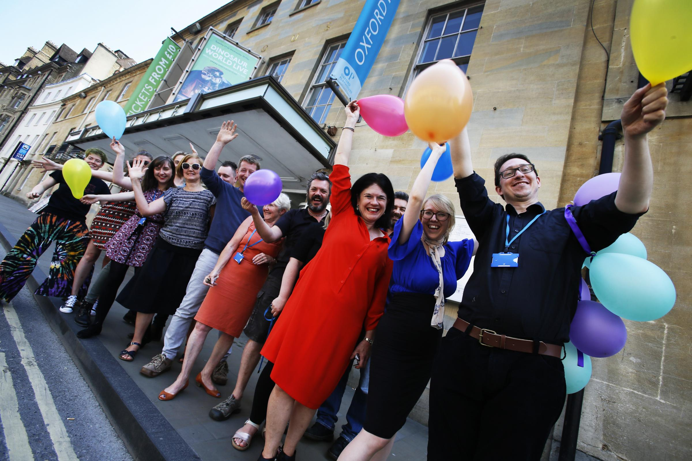 MILESTONE: Oxford Playhouse staff ready to celebrate outside the Beaumont Street theatre Picture: Ed Nix