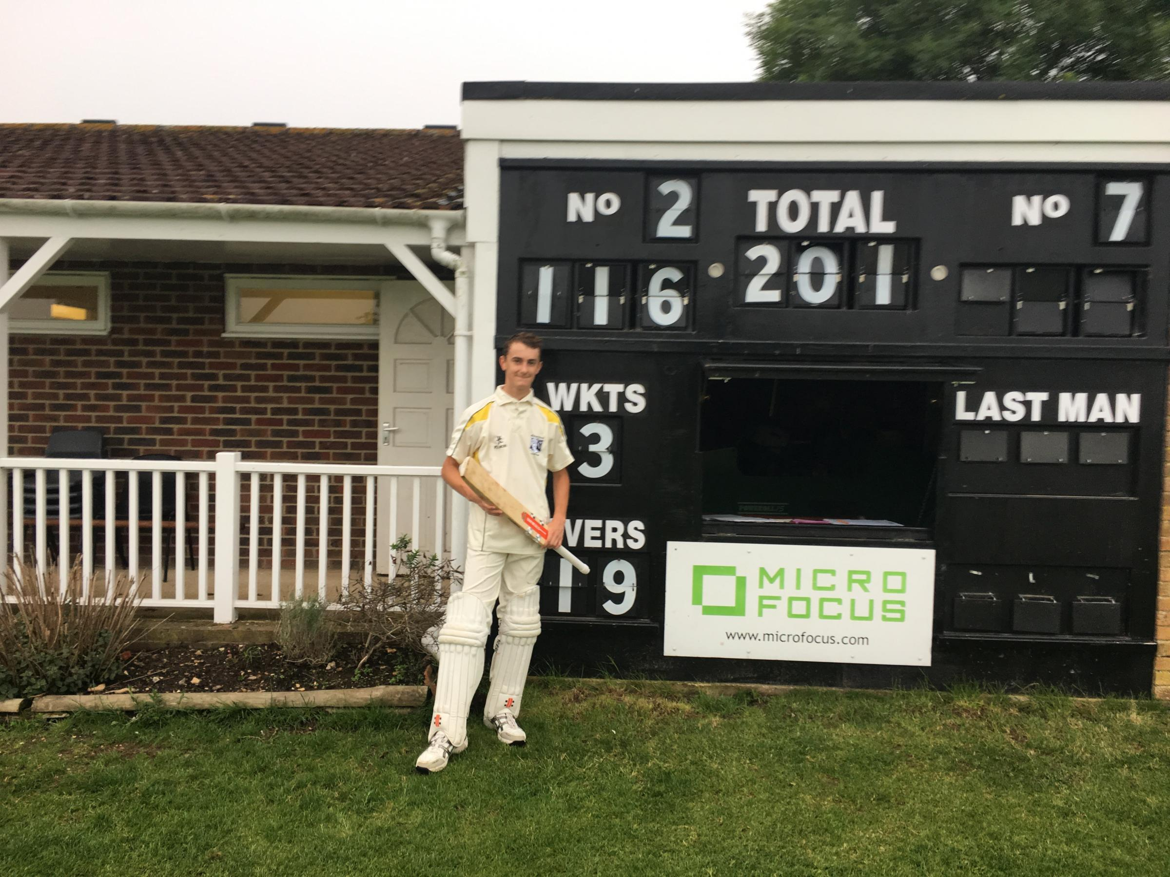 JOY: Liam Turnbull stands proudly after his first hundred