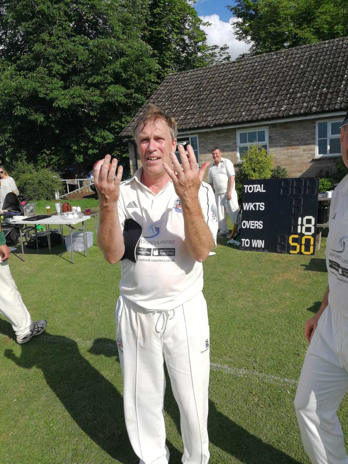 Richard Cook celebrates after his amazing spell of 9-18 for Radley against Steventon