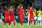 England players celebrate winning the penalty shoot-out against Colombia (Tim Goode/PA).