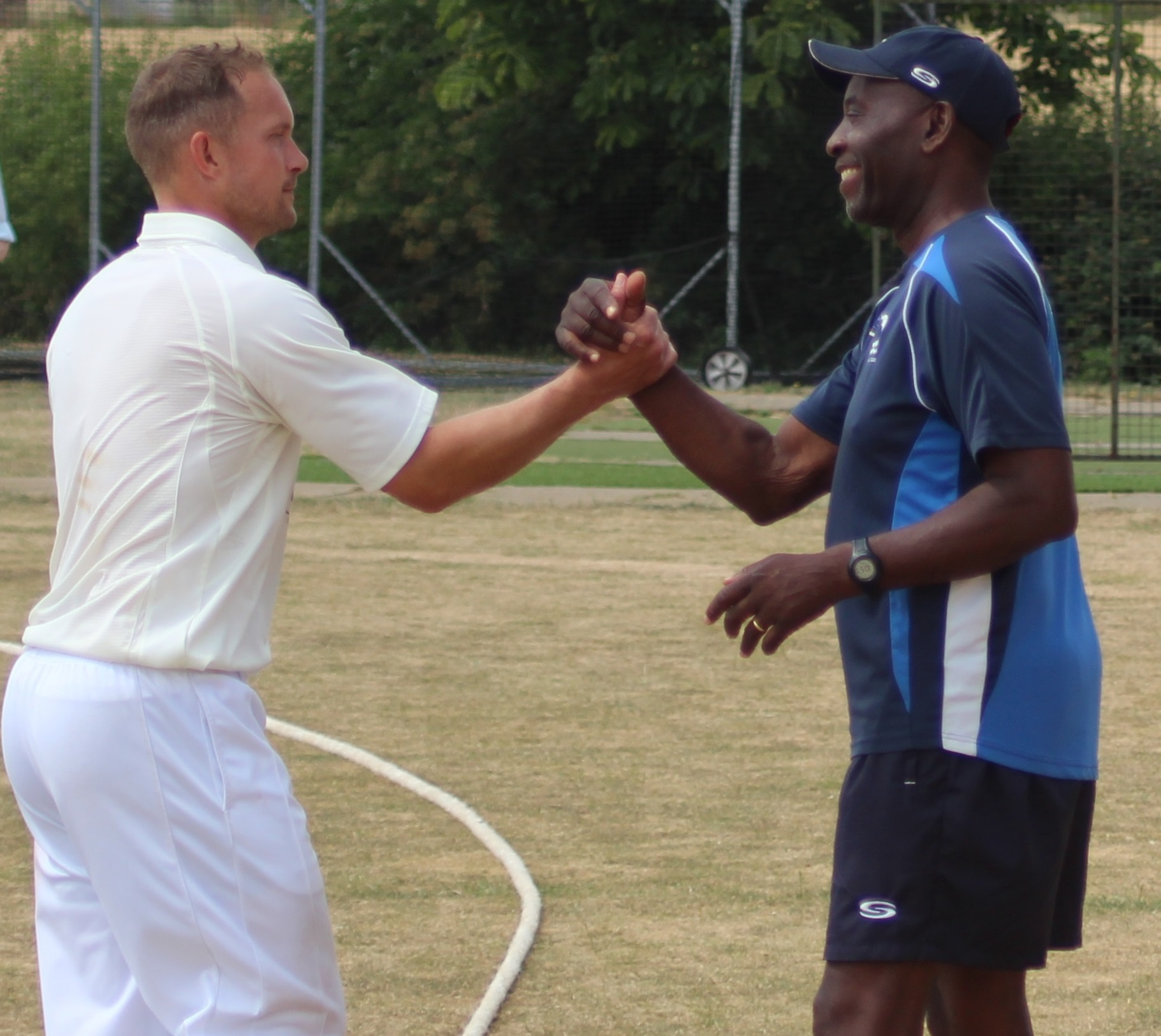 STAR MAN: Gareth Andrew is congratulated by head coach Rupert Evans after his match-winning performance helped Oxfordshire beat Dorset by 121 runs in the Unicorns Counties Championship Picture: Nick Pinhol