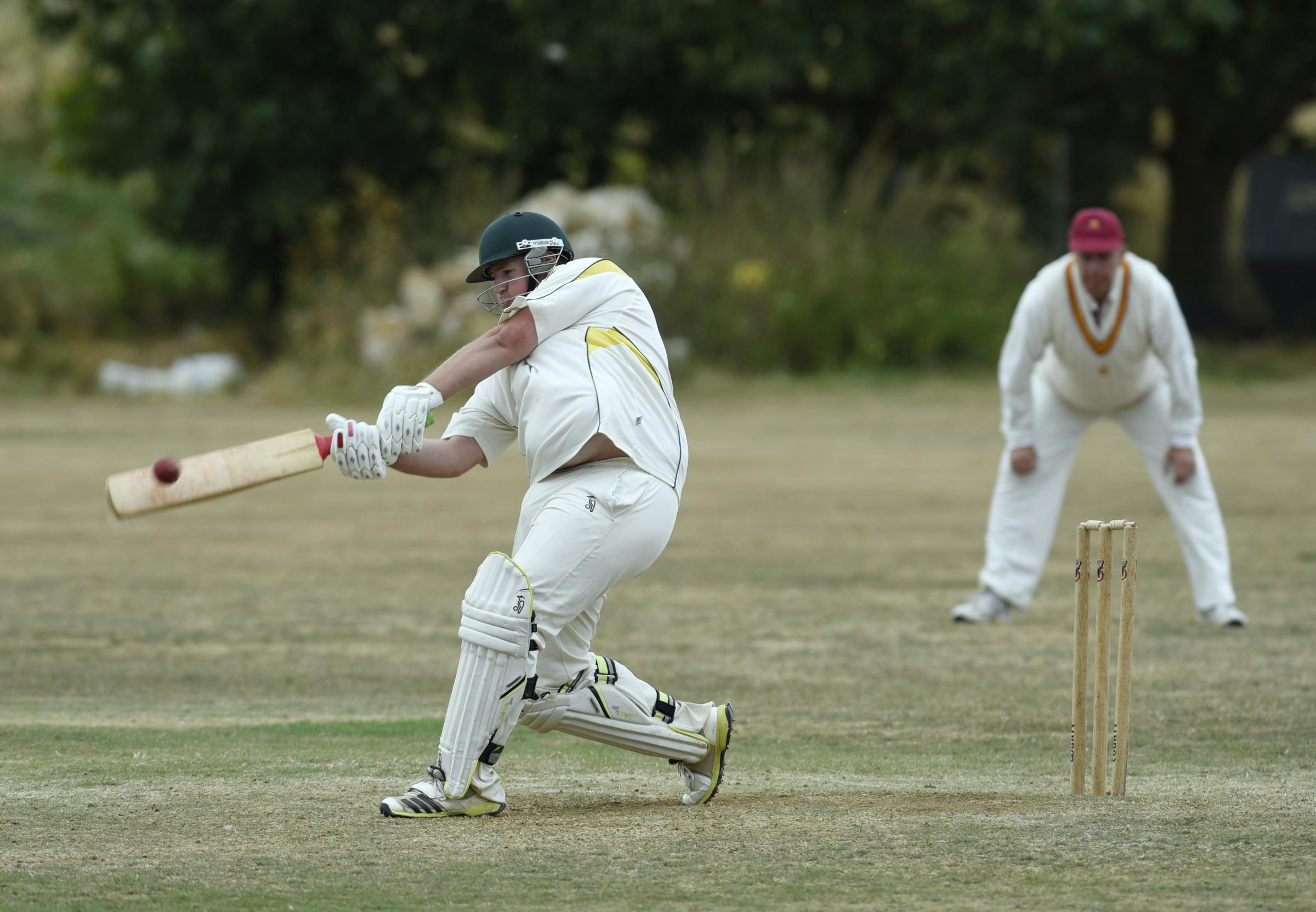 BIG HIT: Wantage's James Mabbett slams a six in the last over of their innings against Stanton Harcourt