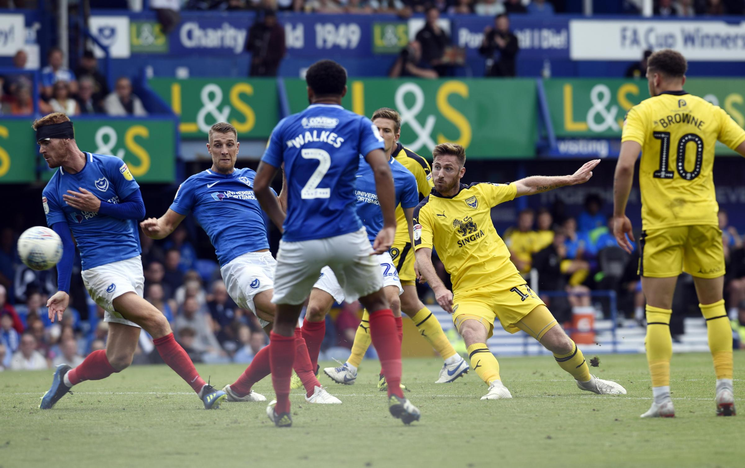 Oxford United's James Henry fires in a shot which hit the post in the second half at Portsmouth  Picture: David Fleming
