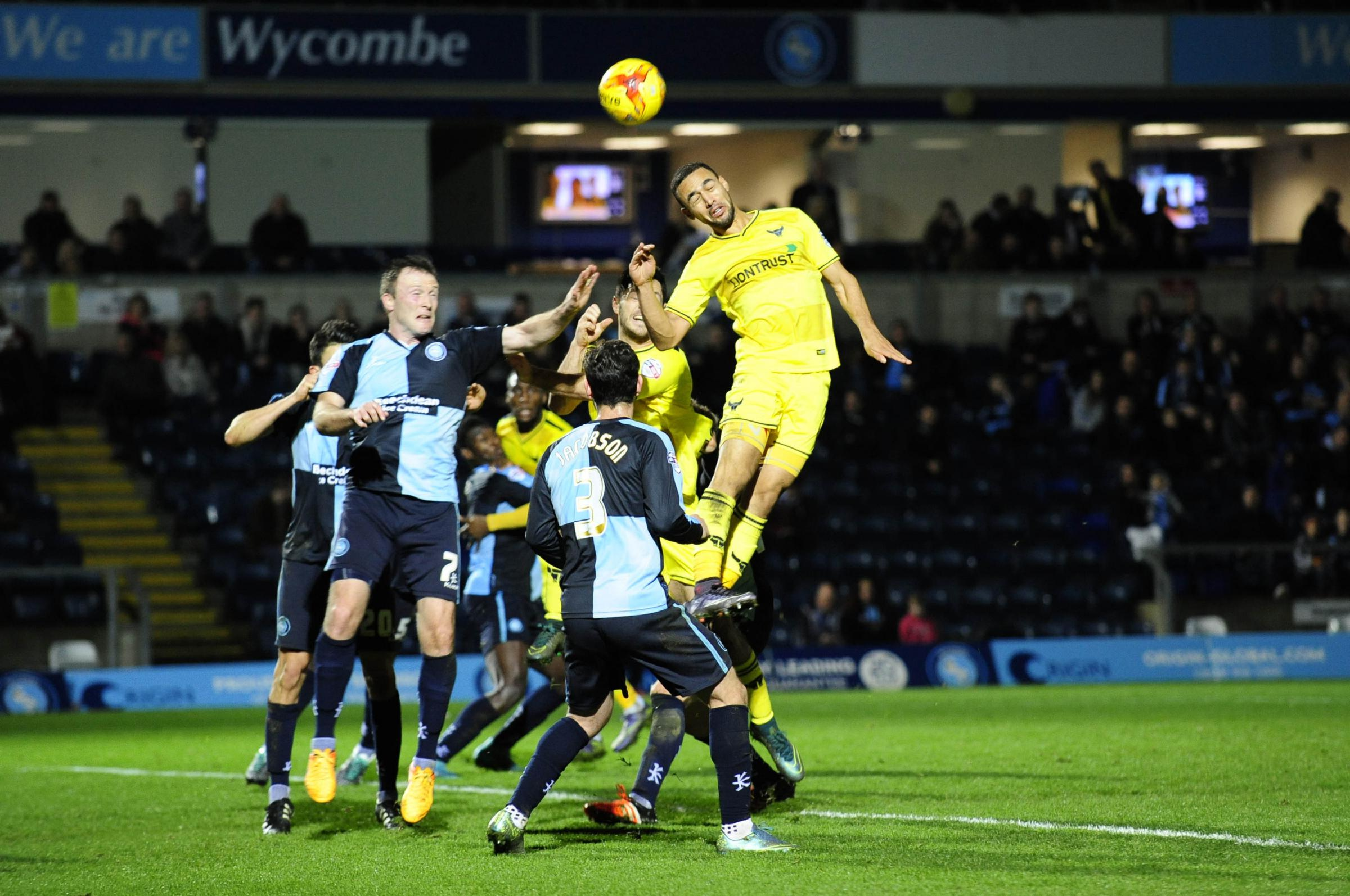 REUNITED: Kemar Roofe wins a header in Oxford United's last visit to Wycombe Wanderers, a 2-1 defeat in 2015  		 Picture: David Fleming