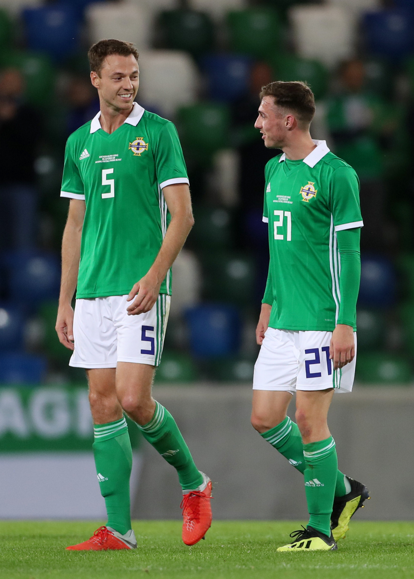 BIG INFLUENCE: Gavin Whyte leaves the field with Northern Ireland's Jonny Evans after scoring on his international debut against Israel on Tuesday nightPicture: Liam McBurney/PA Wire