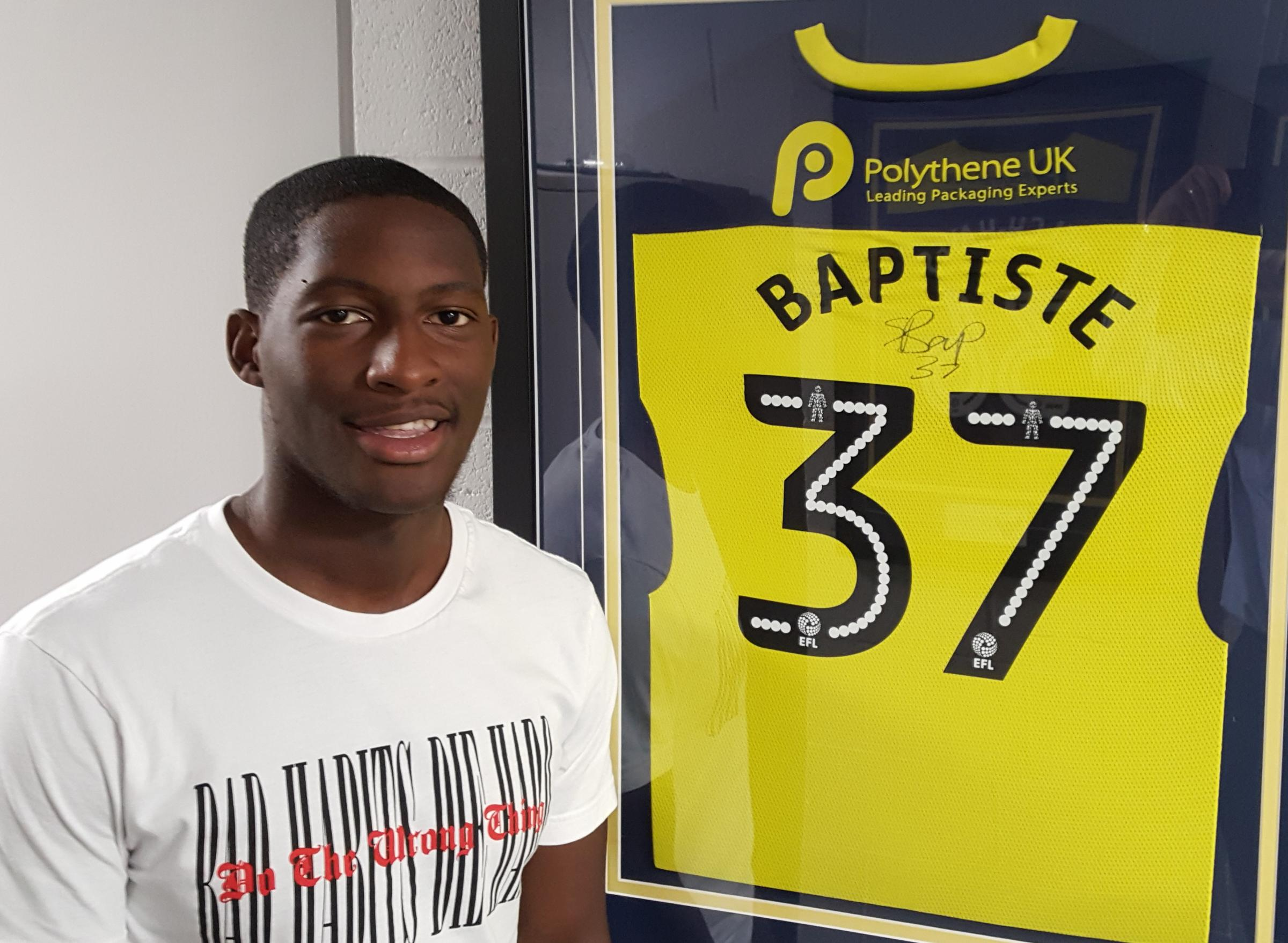 Shandon Baptiste with the shirt in which he made his Oxford United debut, against Stevenage last season