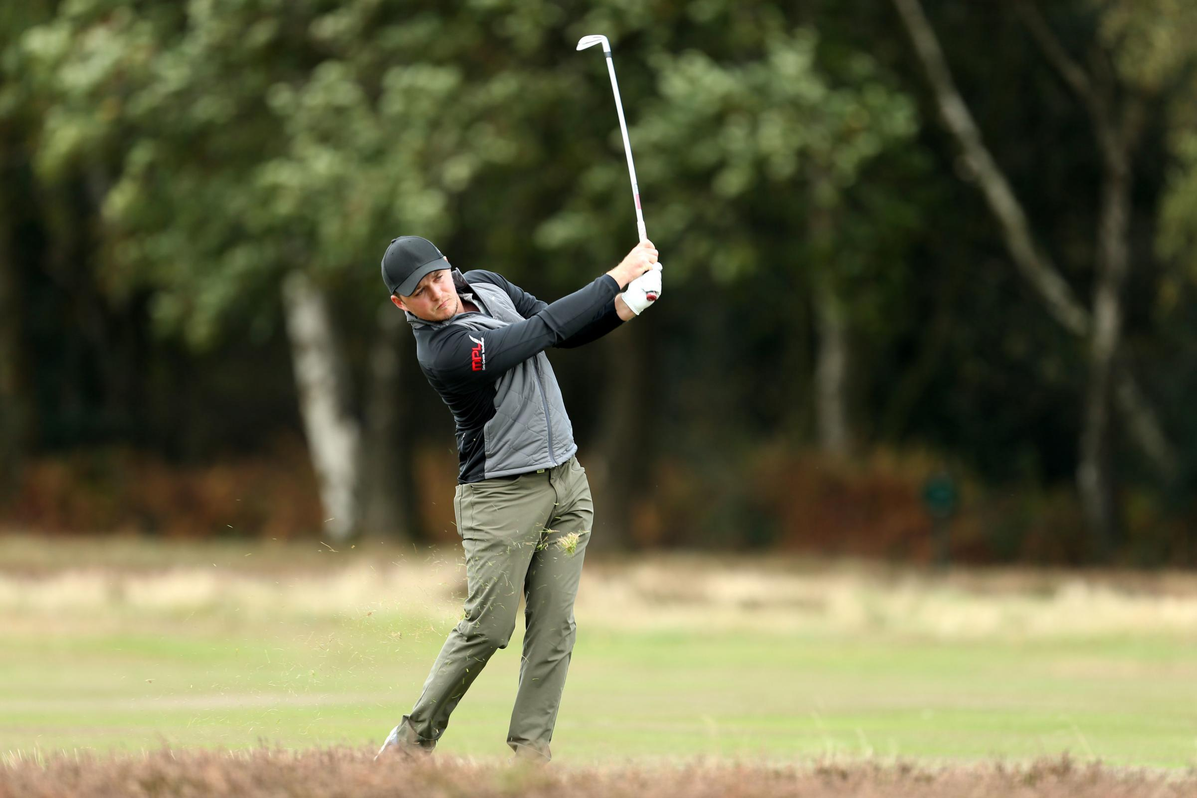 CLASS ACT: Eddie Pepperell on his way to victory in the British Masters, propelling the Oxfordshire ace to number 33 in the world  Picture: Steven Paston/PA Wire