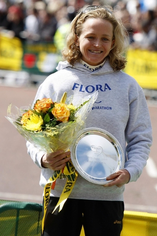 ALL SMILES: Mara Yamauchi on the podium after finishing second at the London Marathon