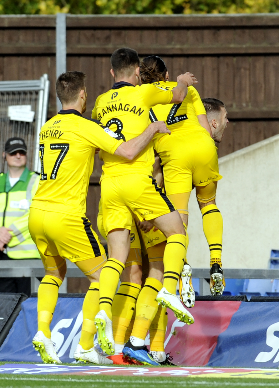 Jamie Mackie is jumped on by his Oxford United teammates after scoring against Plymouth Argyle in the Sky Bet League One bottom-of-the-table clash in OctoberPicture: David Fleming