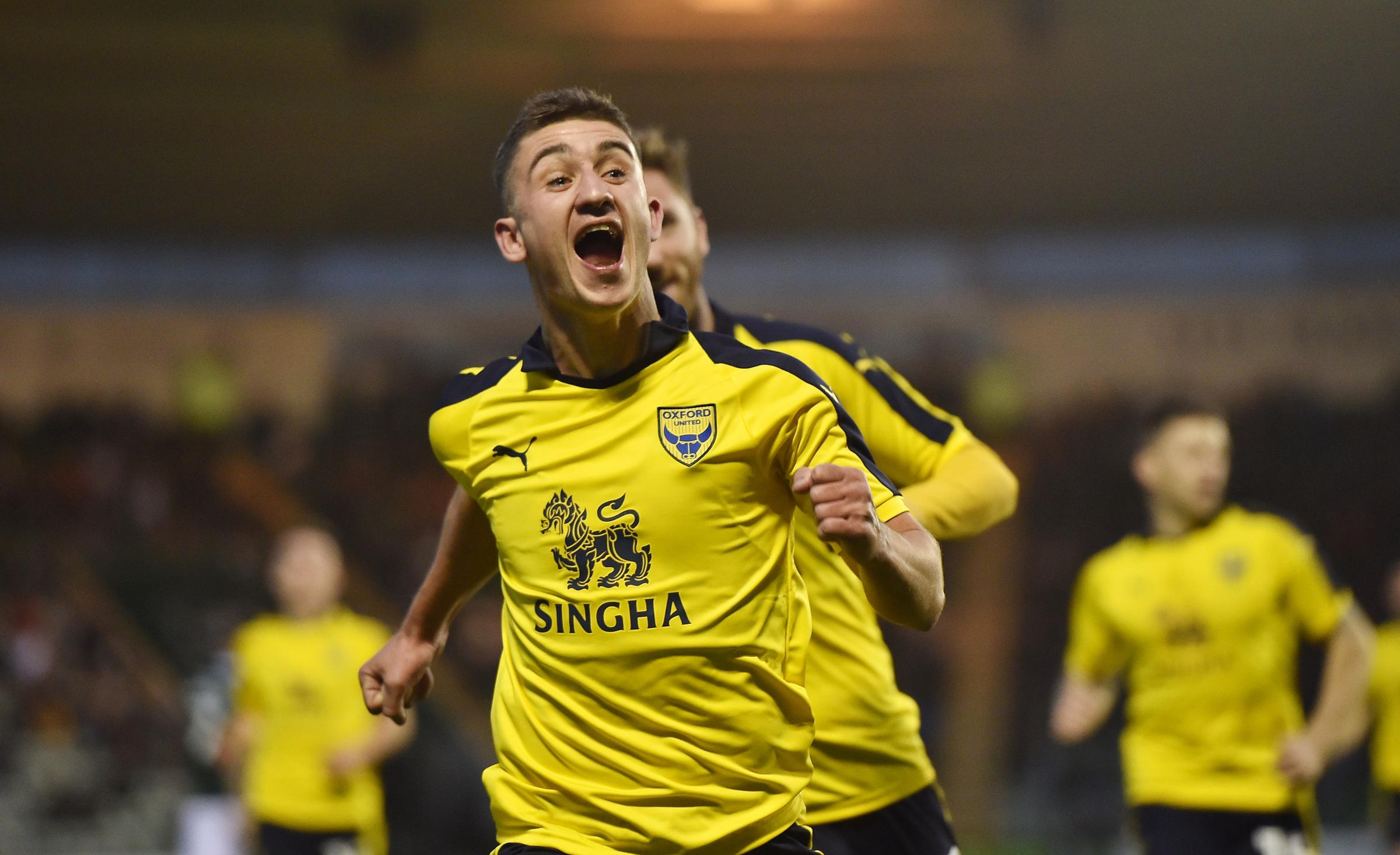An elated Cameron Brannagan races towards the travelling Oxford United supporters after scoring against Plymouth Argyle, but was booked for his celebration Picture: Sean Hernon/PPAUK