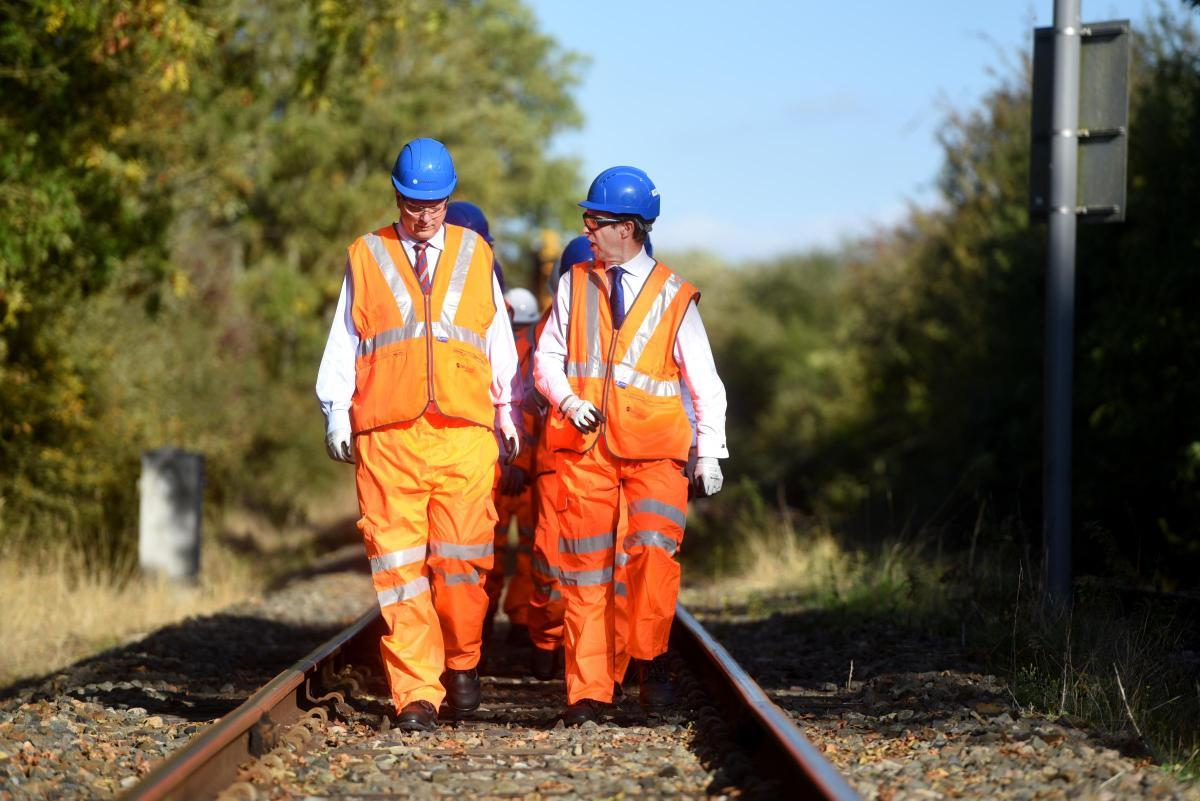 Transport secretary Chris Grayling (left) at Launton crossing near Bicester earlier this year on a visit to oversee East West Rail works