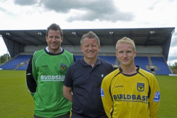 The Oxford Times: New signings Ryan Clarke (left) and Marcus Kelly with manager Chris Wilder