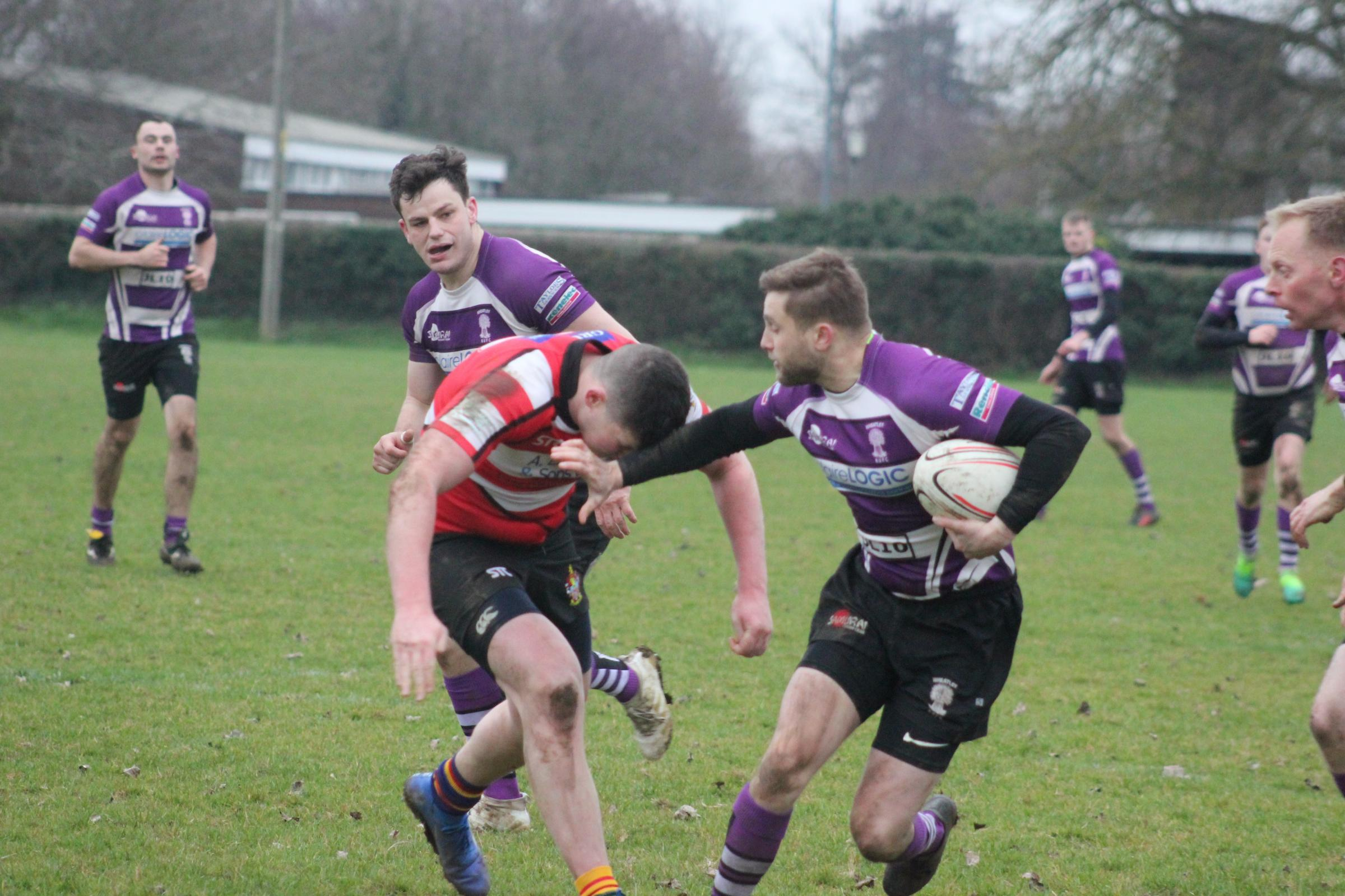 Dan Rule hands off a Didcot tackler during his side's defeat in the BB&O Premier Picture: Simon Chadbone