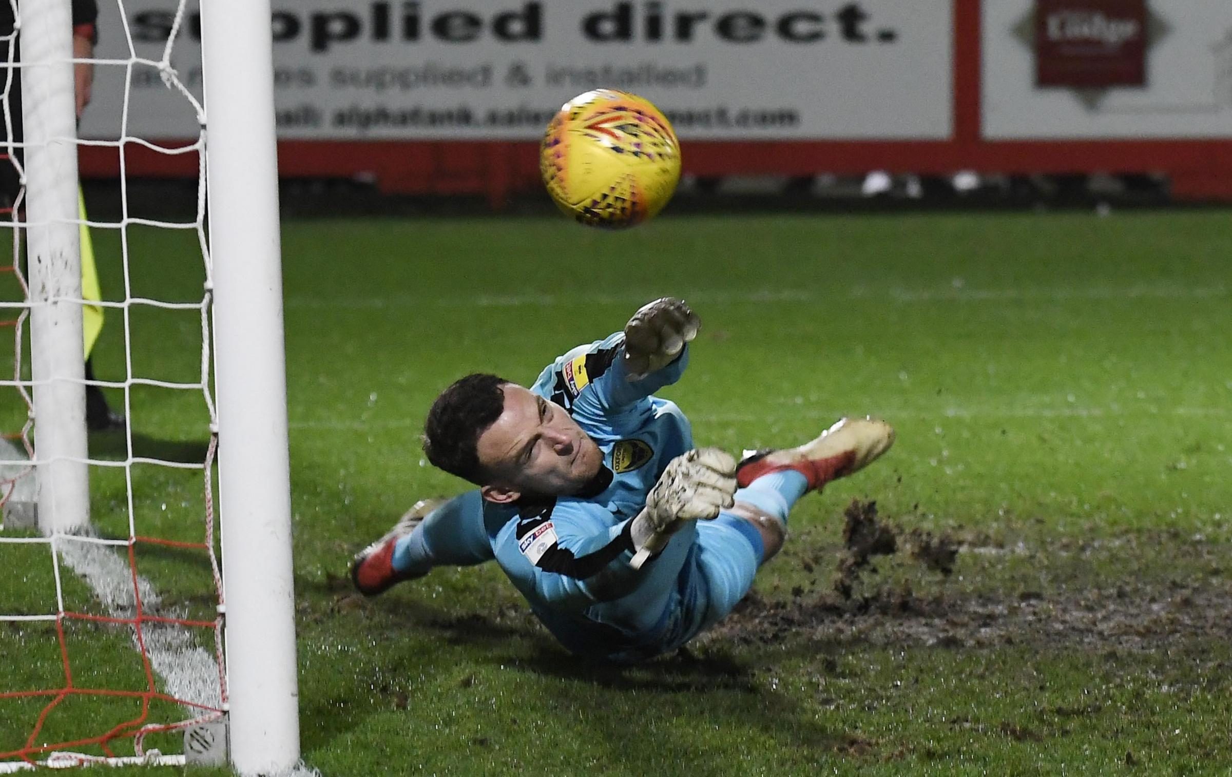 Simon Eastwood dives to make his second save in United's penalty shoot-out victory last nightPictures: David Fleming