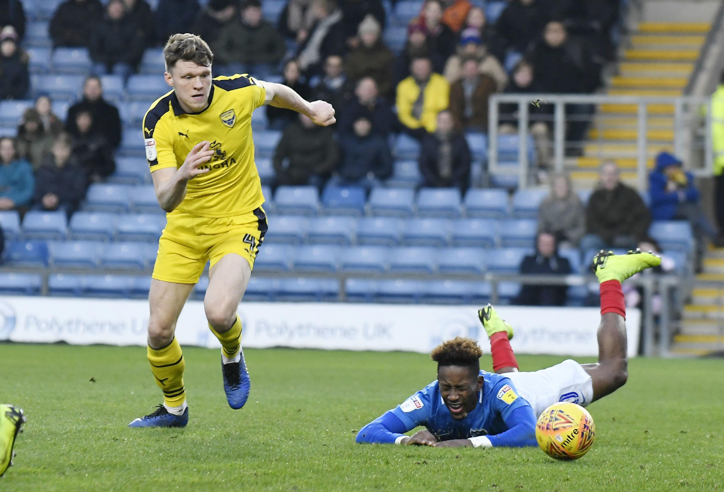 Rob Dickie leaves a Portsmouth rival languishing during Oxford United's win over the table-toppers last month. The U's defender is hoping for more of the same when promotion-chasing Sunderland visit the Kassam Stadium today Picture: David Fle