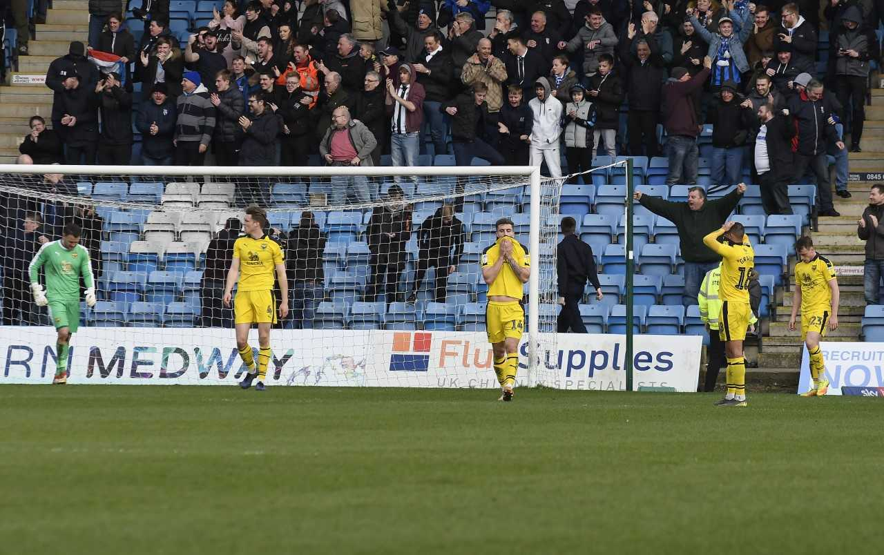 Oxford United's players react to Gillingham's 89th-minute winner  Picture: David Fleming