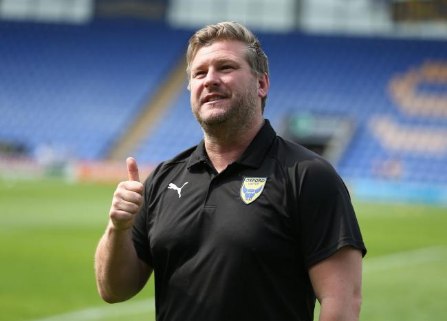 Karl Robinson is excited at the prospect of taking on Rangers at Ibrox